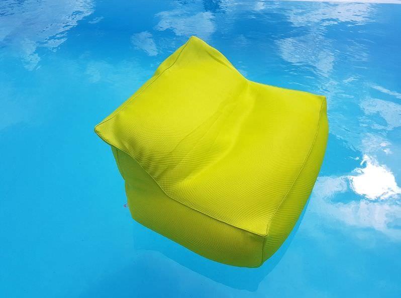 Poltrona galleggiante in tessuto colore giallo